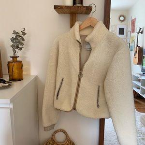 Faux Sheep Fur Jacket with Brown Hem
